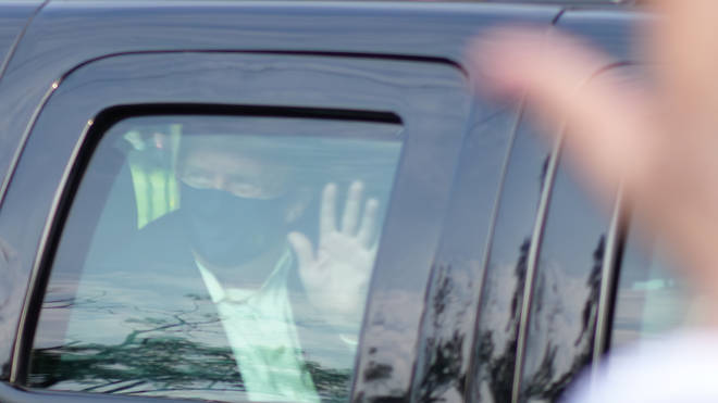 Donald Trump waved to supporters outside Walter Reed, where he is currently being treated for coronavirus