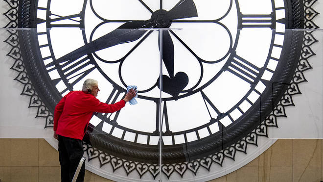 Dougie Cook, from the housekeeping team, cleans the St Enoch Clock in the Antonine Centre in Cumbernauld