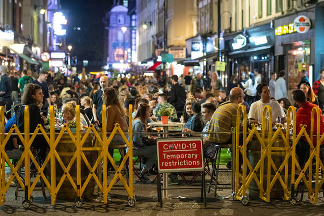 General view of people enjoying a night out in Soho