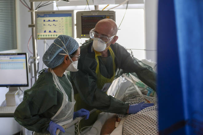 File photo: Doctors treat a patient suffering from coronavirus on an Intensive Care ward at Frimley Park Hospital in Surrey