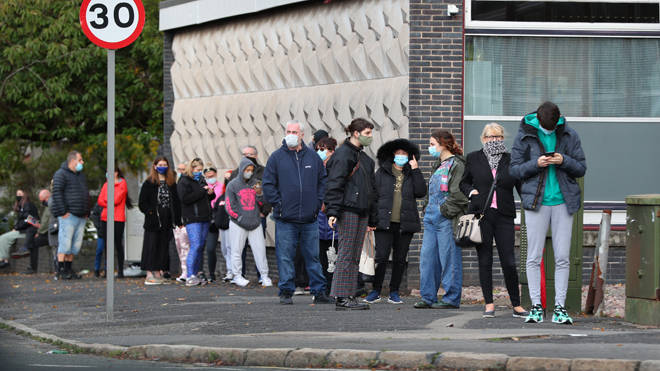 People wait at a testing centre in Liverpool