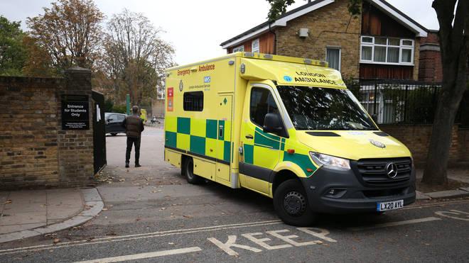 An ambulance leaving La Sainte Union Catholic School in Highgate