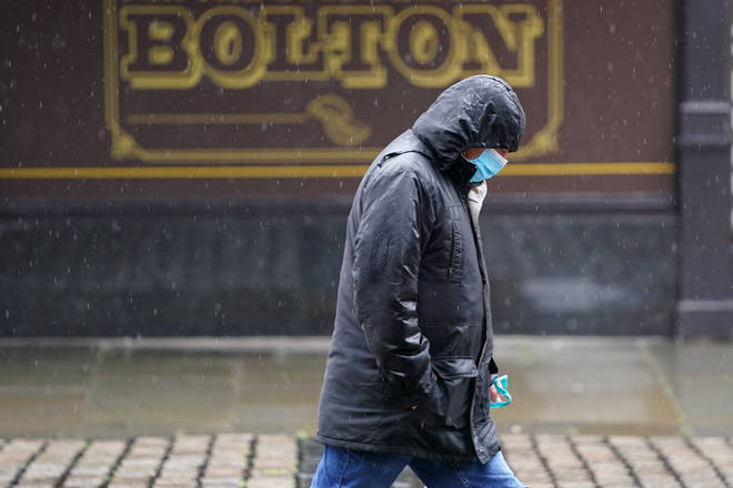 File photo: A man walks on the street in Bolton, Greater Manchester