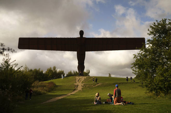 A family enjoy a picnic next to the Angel of the North on September 19, 2020 in Gateshead, United Kingdom.