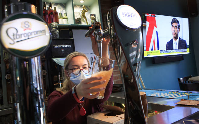 An employee pulls a pint in the Tib Street Tavern in Manchester, as Chancellor of the Exchequer Rishi Sunak announces the new furlough scheme