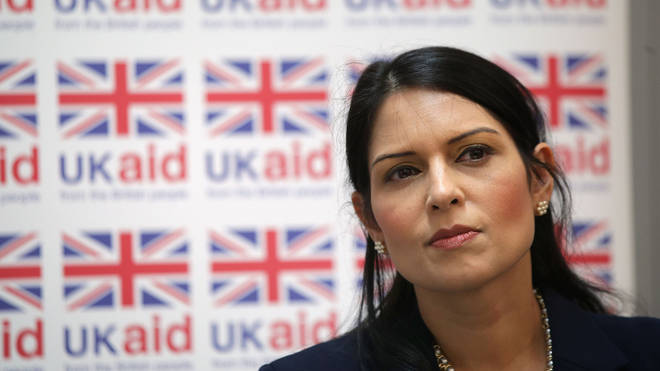 Priti Patel is flying home from a trip to Africa