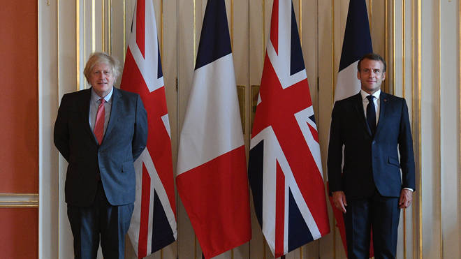 Emmanuel Macron (R) visited the UK and Boris Johnson (L) in June this year