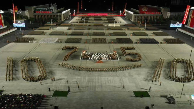Performers lined up in a 75 formation to celebrate the ruling party's anniversary