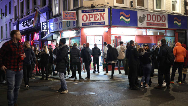 People at an off licence in Soho after the 10pm curfew last night