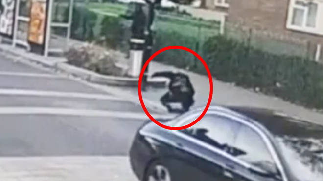 This is the moment the officer was jettisoned from the bonnet of the Mercedes