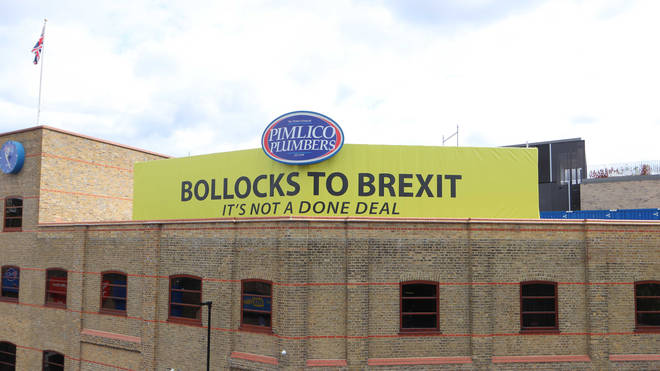 """The """"Bollocks to Brexit"""" sign on top of the Pimlico Plumbers building in central London"""
