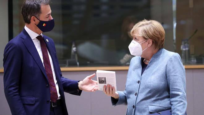 German Chancellor Angela Merkel, right, speaks with Belgium's Prime Minister Alexander De Croo