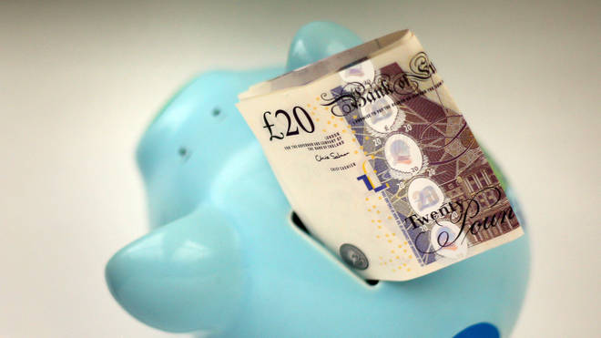 A piggy bank and a £20 note