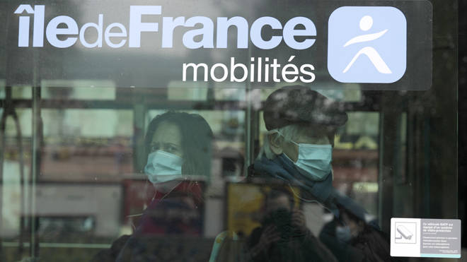 People in coronavirus masks on a bus in Paris