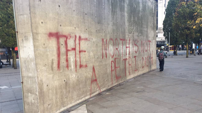 Graffiti stating 'the North is not a petri dish' was sprayed onto a wall in Manchester overnight