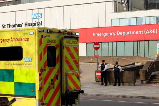 File photo: Police waves to an ambulance outside St Thomas' Hospital