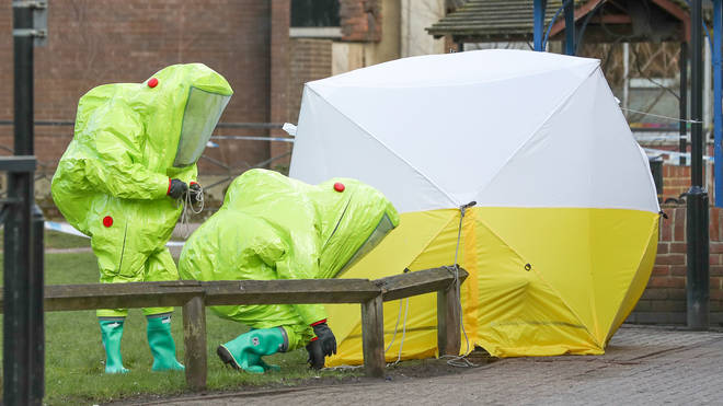 Police in hazmat suits at the site of the poisoning in April 2018