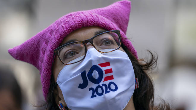 Demonstrators rally during the Women's March outside the New York Stock Exchange (Mary Altaffer/AP)