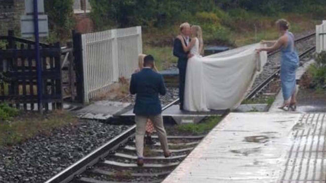 The couple were spotted taking wedding pictures on train tracks