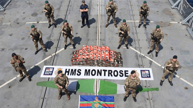 An HMS Montrose boarding team pose with the drugs