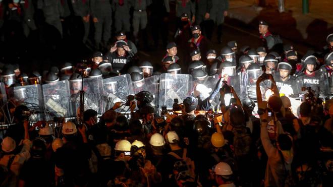 Pro-democracy activists confront a police blockage