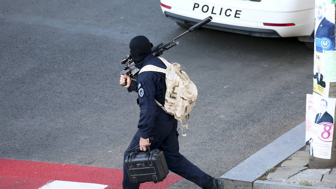 A Georgian police sniper carries his rifle