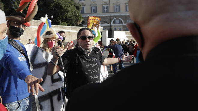 Disco and dance club operators stage a protest against government's order for them to close in Rome