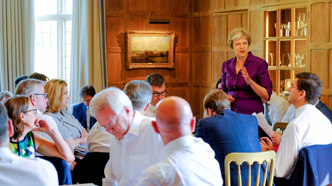 Theresa May speaking to Cabinet Ministers at Chequers