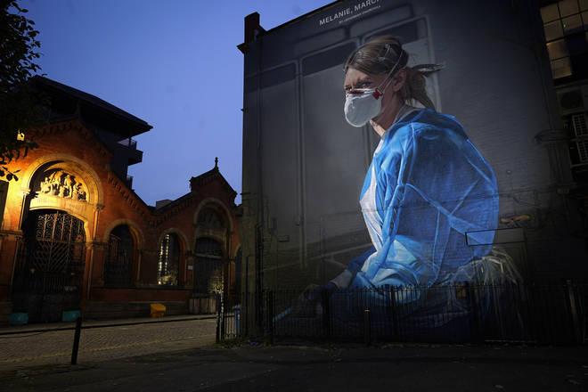 A mural depicting NHS nurse Melanie Senior, based on a photograph by Johannah Churchill.