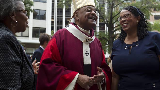 Washington DC Archbishop Wilton Gregory greets churchgoers at St Mathews Cathedral