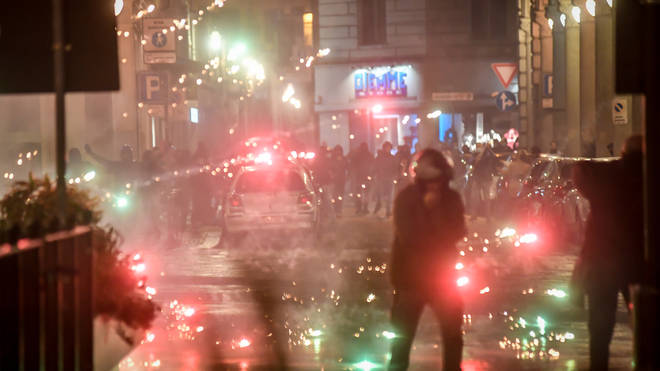 Police detained at least 5 people after violence erupted in Turin