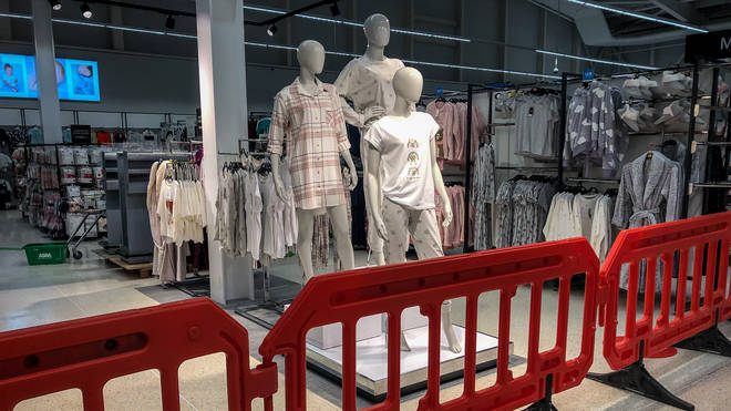 The clothing area in a supermarket near Cardiff is deemed non-essential items and is cordoned off