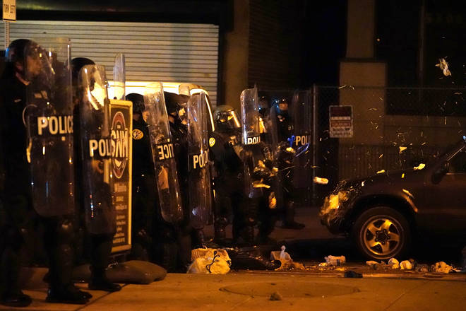 Debris is thrown at police during a demonstration in Philadelphia