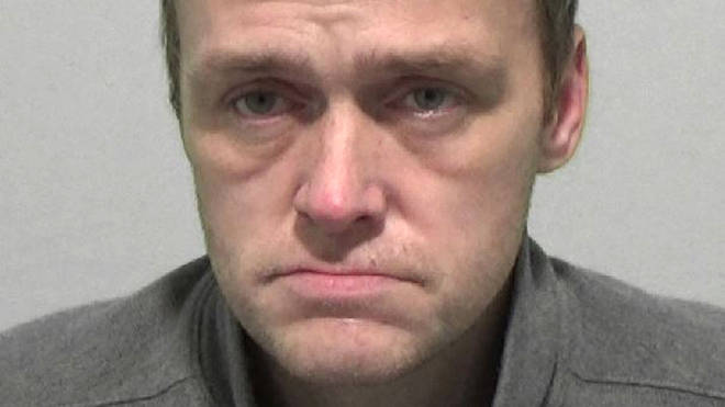 Mark Cooper, 41, was found asleep next to a half-eaten cheesecake