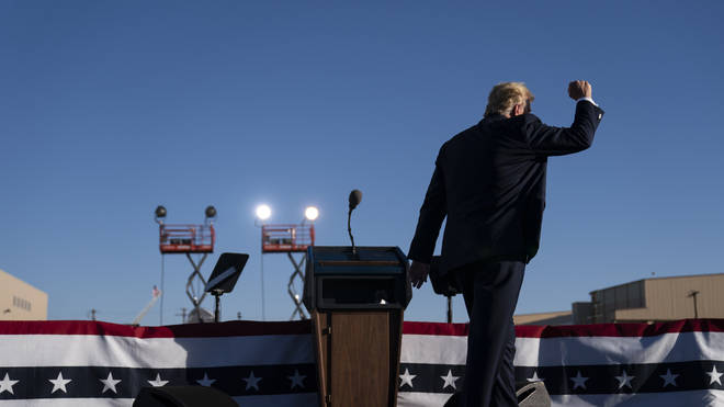 President Donald Trump walks off stage after speaking during a campaign rally