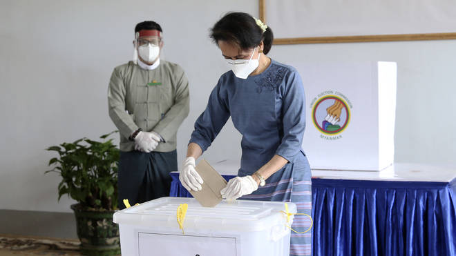 Burma's leader Aung San Suu Kyi casts an early vote for the upcoming November 8 general election (Aung Shine Oo/AP)