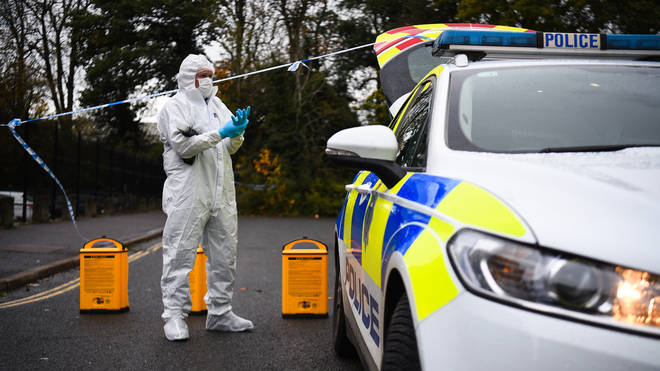 A forensic officer at the scene on Russell Way in Crawley, West Sussex, after a 24-year-old man was fatally stabbed