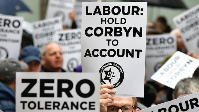 Protesters during the demonstration organised by the Campaign Against Antisemitism outside the Labour Party headquarters