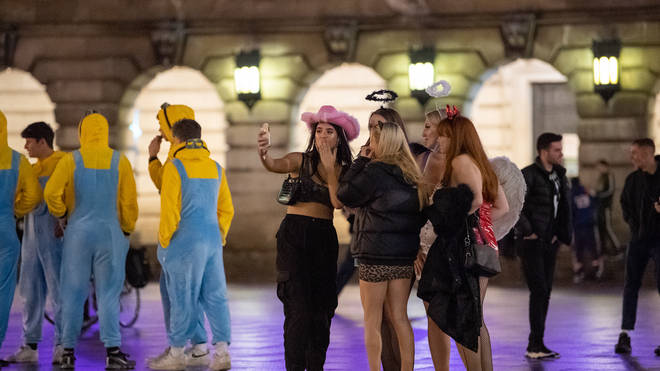 youngsters were seen posing for photographs dressed as minions from the film Despicable Me and chanting near police vehicles.