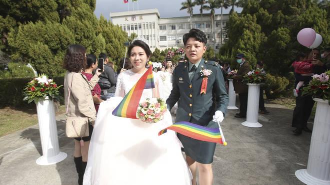 Lesbian couple Chen Ying-hsuan, right, and Li Li-chen attend a military mass weddings ceremony in Taoyuan city, northern Taiwan (Chiang Ying-ying/AP)