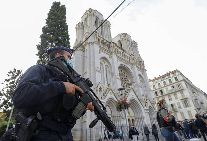 Police guard the scene after the attack in Nice