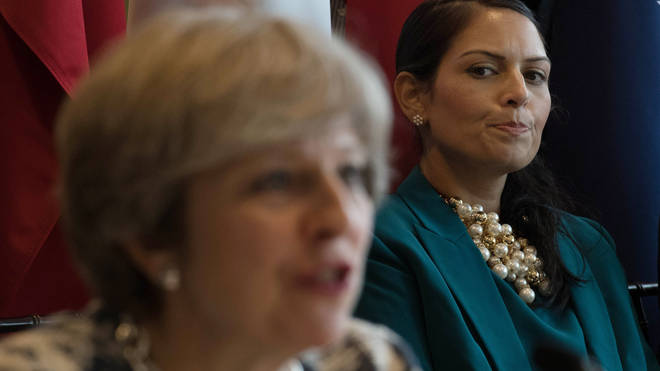 Theresa May and Priti Patel