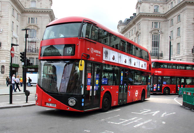 London buses turn the corner onto Piccadilly Circus