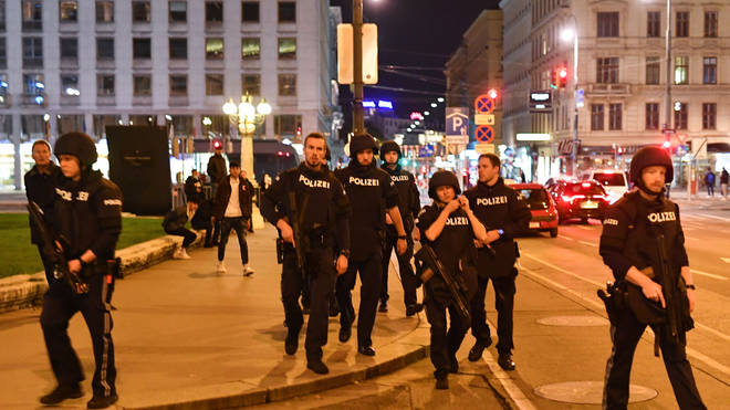 Armed police arrive at the first district near the state opera in central Vienna on November 2, 2020, following a shooting near a synagogue