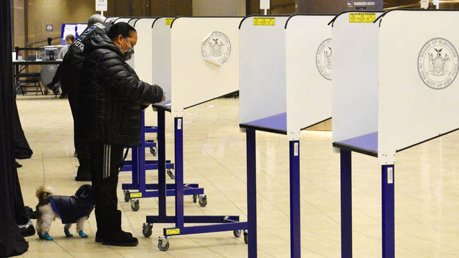 : People vote at a polling station at Madison Square Garden Arena on Election Day