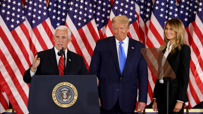 Donald Trump appears alongside Vice President Mike Pence on election night