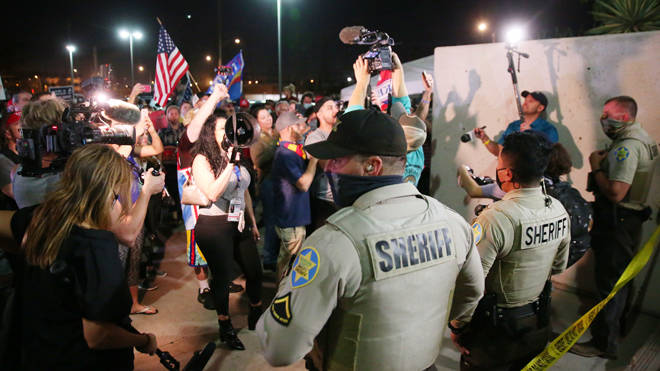 Police and protesters outside the Election Centre in Phoenix, Arizona