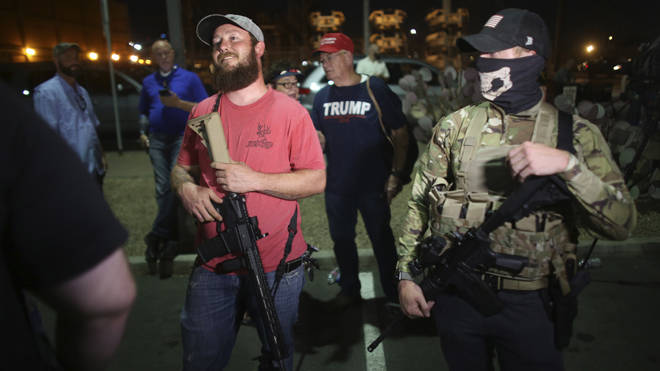 Armed Trump supporters stand outside of Maricopa County Recorder's Office