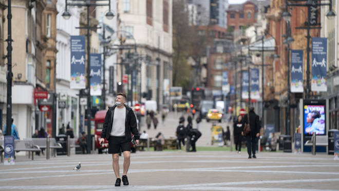 A man walks in the centre of Leeds during the second lockdown