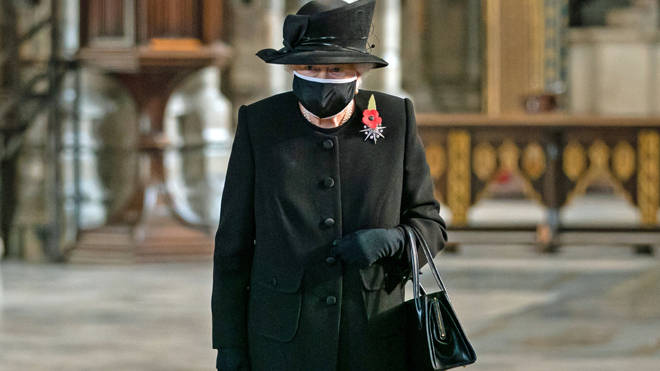 The Queen wore a black mask edged with white